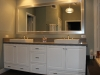Master bathroom remodeling in Los Angeles with two sinks, white vanity, big white frame mirror, caesar stone counter top