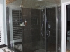 Modern shower remodeling in Los Angeles with frameless shower door, dark brown Porcelain tile