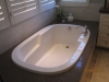 Inlay tub in Los Angeles with Caesar stone around as deck