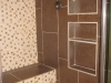 Custom shower with a bench, build in wall, mosaic tile in Santa Monica