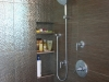 Custom shower remodeling with build in inside wall for shampoo