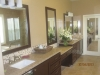Custom double sink vanity, two level vanity with Caesar stone counter top, brown frame mirrors
