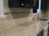 Travertine back splash and Granite Counter top