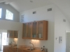 Open floor, room addition in Simi Valley with white color walls and recess lighting