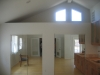 room addition with high ceiling, big, white windows, light color hardwood floor