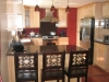 Room addition and kitchen remodeling with Maple wood, dark color hardwood floor, pendents light over the peninsula, build in fridge, dark color Granite counter top