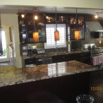 Kitchen remodeling with dark cabinets and Granite counter top.